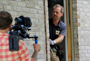 Photo of Mike Shadoan, President and Owner of Radiant Windows and Remodeling, during filming of an episode of Designing Spaces featured on the Lifetime Channel